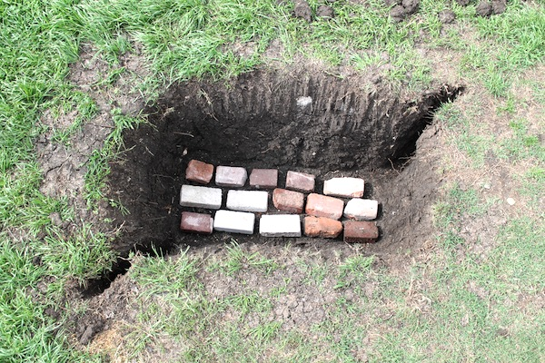 layering bricks in pig pit